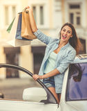 Girl shopping with the car Stock Photo