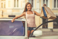 Girl shopping with the car Royalty Free Stock Photo