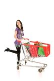 Girl with shopping cart. Over white background Stock Image