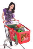 Girl with shopping cart Royalty Free Stock Photography