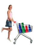 Girl with shopping cart. Happy girl with shopping cart Stock Images