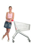 Girl with shopping cart. Happy girl with shopping cart Royalty Free Stock Image