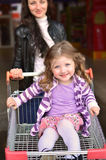 Girl in a shopping cart Royalty Free Stock Images