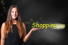 Girl with shopping cart Stock Photos