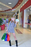 Girl with shopping and cash Stock Photography