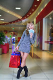 Girl with shopping and cash Stock Photo