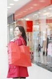 The girl in shopping centre Stock Photos