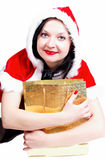 Girl with shopping for Christmas isolated Stock Photo