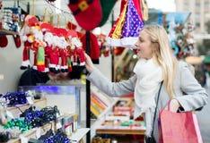 Girl shopping at Christmas market Royalty Free Stock Photography