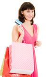 Girl with shopping and debit card Stock Photography