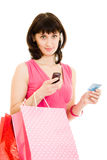 Girl with shopping and debit card Royalty Free Stock Images