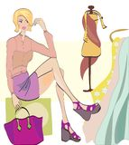 Girl on Shopping. Fashion Shop with Clothes and Fa. Brics and Textiles Royalty Free Stock Photography
