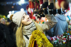 Girl shopping at festive fair Royalty Free Stock Images