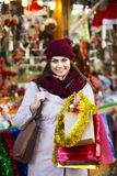 Girl shopping at festive fair. Happy girl shopping at festive fair before Xmas royalty free stock images