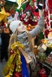 Girl shopping at festive fair Royalty Free Stock Photography