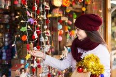 Girl shopping at festive fair Stock Images