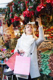 Girl shopping at festive fair Stock Images