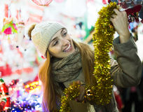 Girl shopping at festive fair Royalty Free Stock Photography