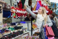 Girl shopping at festive fair Royalty Free Stock Photos