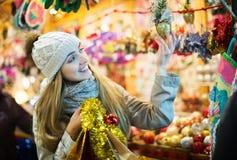 Girl shopping at festive fair Stock Photo