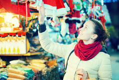 Girl shopping at festive fair before Xmas in evening time Stock Photography