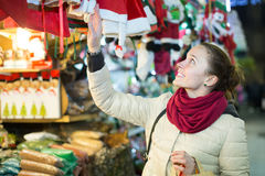 Girl shopping at festive fair before Xmas in evening time Stock Images