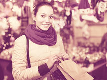 Girl shopping at festive fair before Xmas in evening time Royalty Free Stock Photography