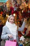 Girl shopping at festive fair Stock Photos