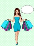 Girl with shopping. I bought a lot of clothes. Gift bags. Fashion illustration. Pop art. Text bubble. Compulsive buying disorder, or oniomania. Girl with Royalty Free Stock Photos