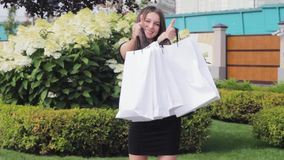 Girl shopping like finger   thumbs  thumbs  sales. Girl shopping like finger thumbs thumbs sales walk stock footage