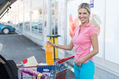 Girl After Shopping Loading Grocery in Car Supermarket Stock Image