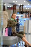Girl shopping in mall Royalty Free Stock Photo