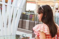 Girl in shopping mall Stock Images