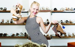 Girl shopping many shoes pairs Royalty Free Stock Photography
