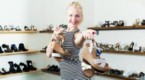 Girl shopping many shoes pairs Royalty Free Stock Photos