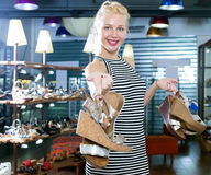 Girl shopping many shoes pairs Stock Images