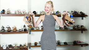 Girl shopping many shoes pairs Royalty Free Stock Photos