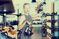 Girl shopping many shoes pairs Royalty Free Stock Images