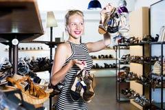 Girl shopping many shoes pairs Royalty Free Stock Photo