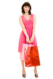 Girl with shopping in the red dress Royalty Free Stock Photos