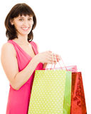 Girl with shopping in the red dress Royalty Free Stock Photography
