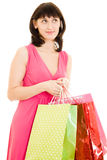 Girl with shopping in the red dress Royalty Free Stock Images