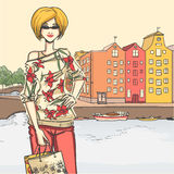 Girl and shopping. Series Urban fashion. Street panorama and slender glamour blonde woman after shopping. architectural structures, bridges Royalty Free Stock Photography
