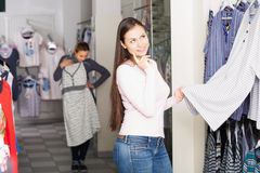 Girl shopping sleepwear for man Royalty Free Stock Photos