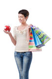 Girl after the shopping spree. On white stock image