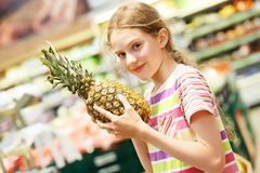 Girl shopping at supermarket Royalty Free Stock Image