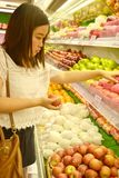 Girl shopping at supermarket Royalty Free Stock Photography