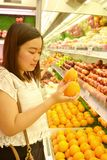 Girl shopping at supermarket. Girl shopping fruit at the supermarket Royalty Free Stock Image