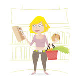 Girl shopping in a supermarket. stock photo