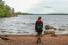 Girl on the shore of a lake Stock Photography